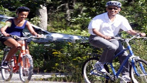 Obama Watch: Pres. Obama and Malia's Bike Ride