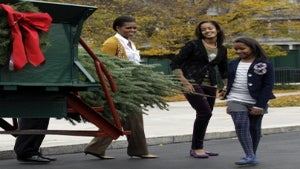 Michelle Obama and Daughters Welcome Christmas Tree