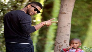 Star Gazing: Usher and Son Spread Peace and Love