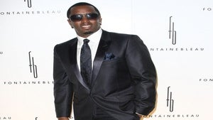 Diddy Pays for Model's Torched Hair
