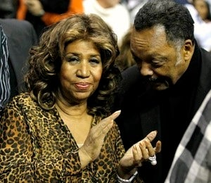 Aretha Steps Out to Pistons Game with Rev. Jackson