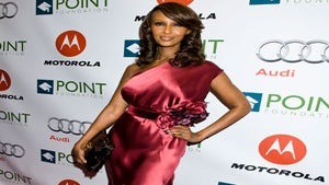 Star Gazing: Iman Goes Glam in Red Silk Gown