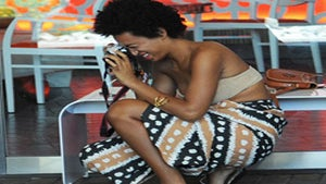 Star Gazing: Solange Gets Puppy Love at Coachella