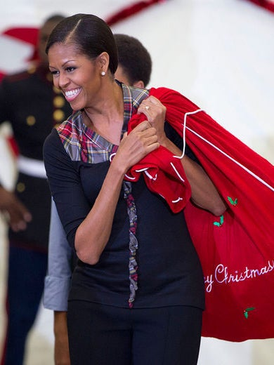 First Lady Celebrates the Season of Giving, Accepts Marine's Date