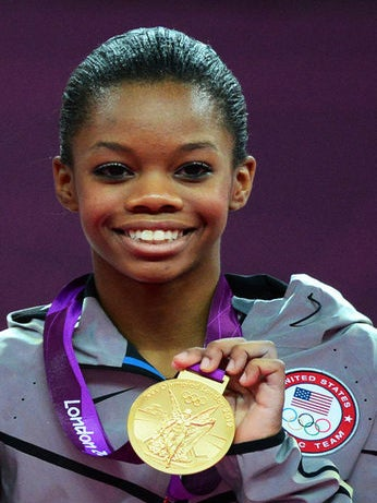 EXCLUSIVE: Gabby Douglas and Mom Natalie Hawkins on Historic Win, Hair, and Inspiring Black Girls
