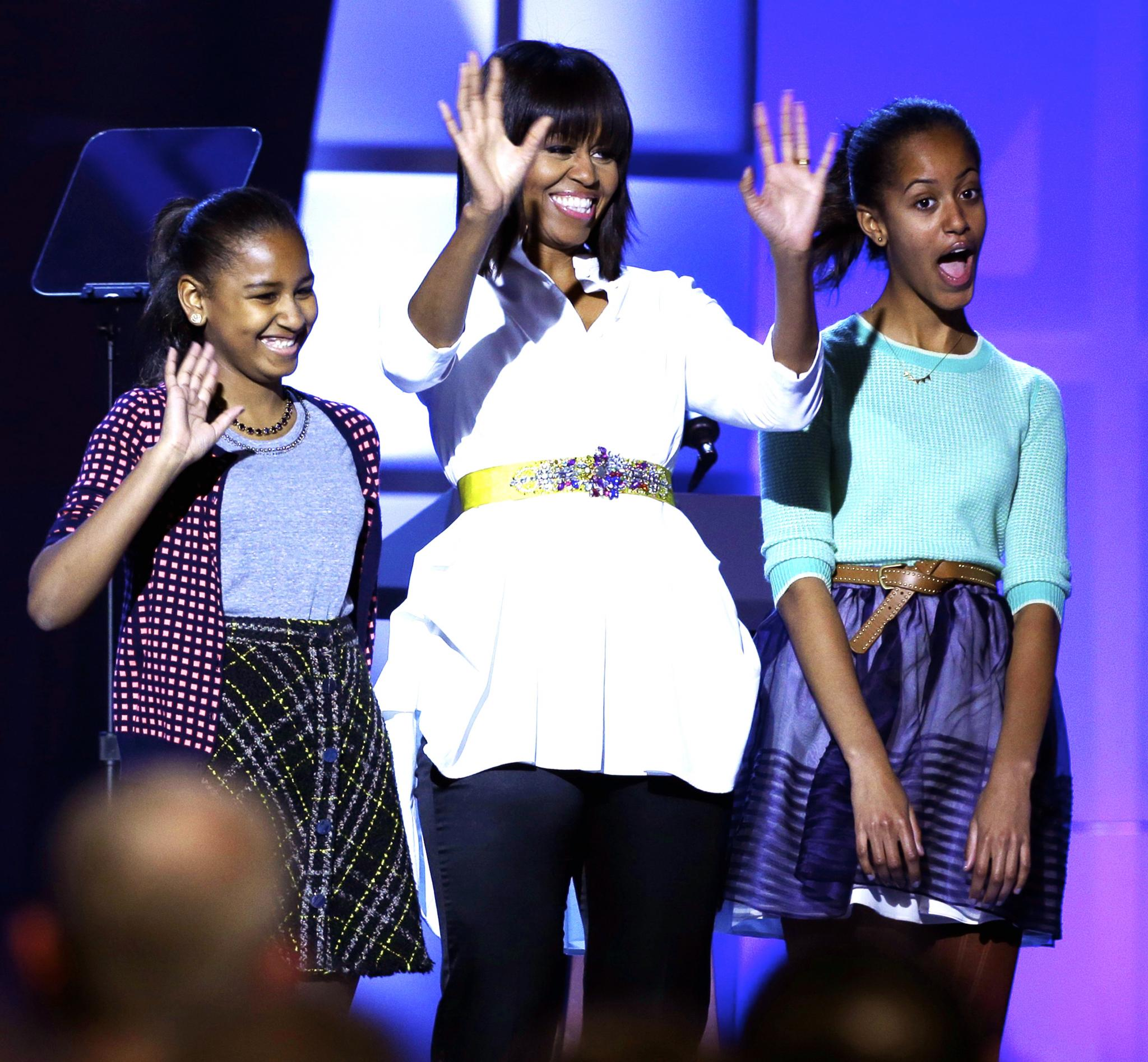 Michelle Obama and Daughters Sasha and Malia Attend 'On the Run' Concert