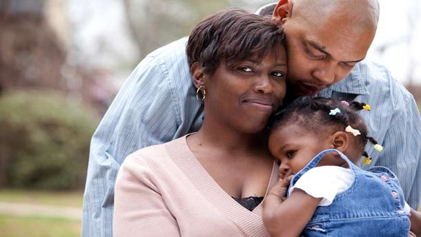 Life Goes On After HIV: She's Positive, Her Husband and Kids Are Not