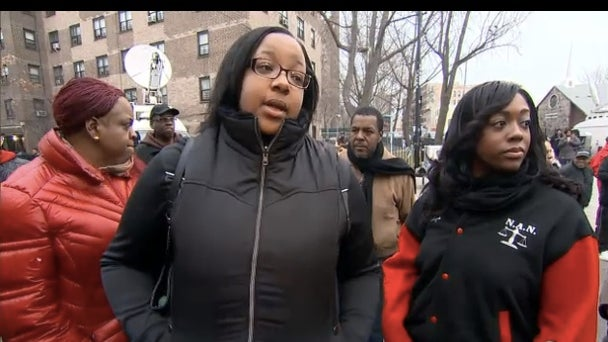 Eric Garner's Daughter Visits NYPD Memorial