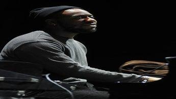 ESSENCE Festival Artist Robert Glasper Reflects on Miles Davis' 90th Birthday