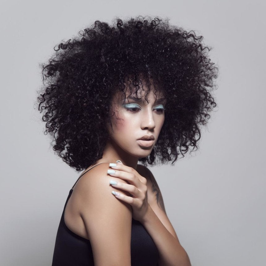How To Master a Twist-Out On Relaxed Hair