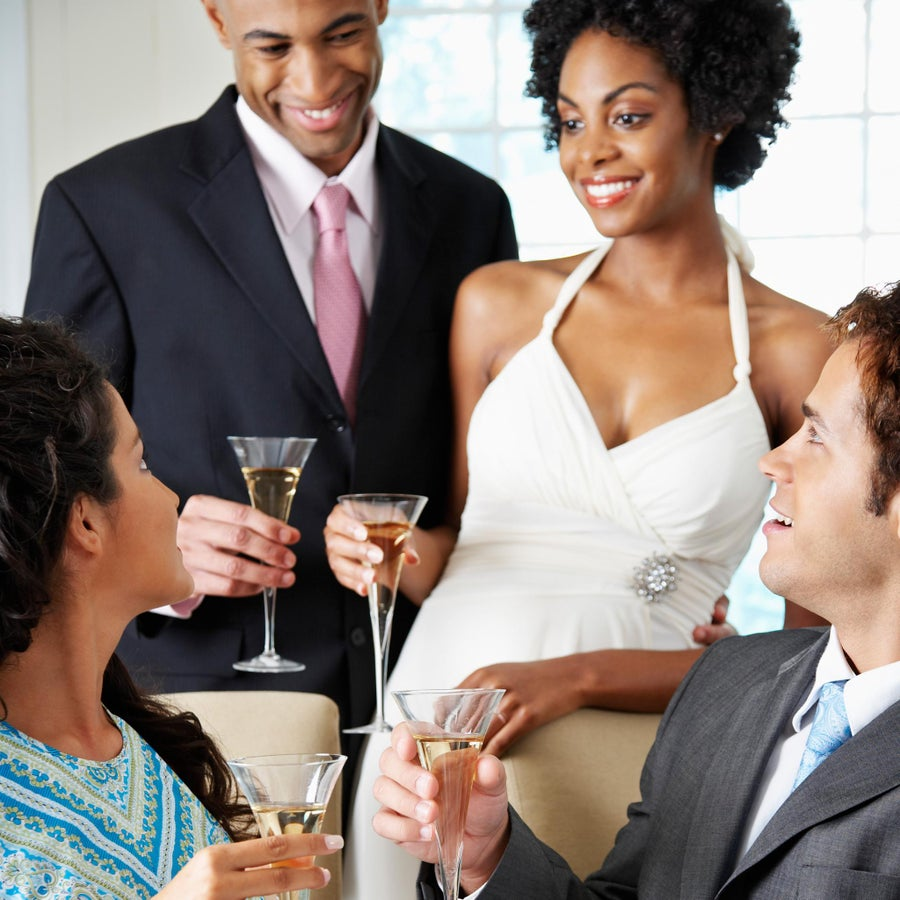ESSENCE Poll: Would You Be Angry if One of Your Guests Proposed on Your Wedding Day?