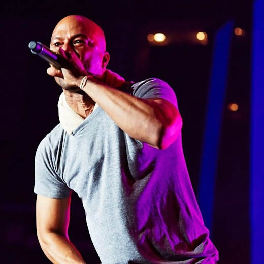 Common Freestyles to a Fan on Stage at Essence Fest