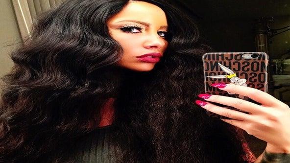 New Hair Alert: Amber Rose Wears Long, Brown Weave