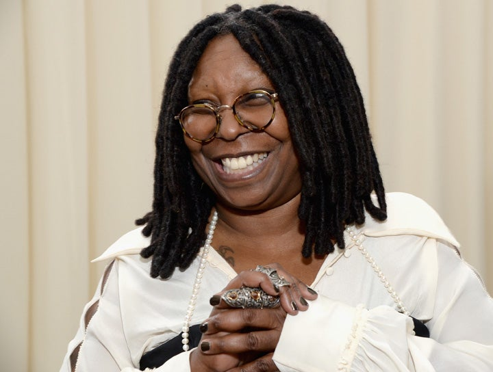 Whoopi Goldberg Debuts Holiday Sweater Line Essence