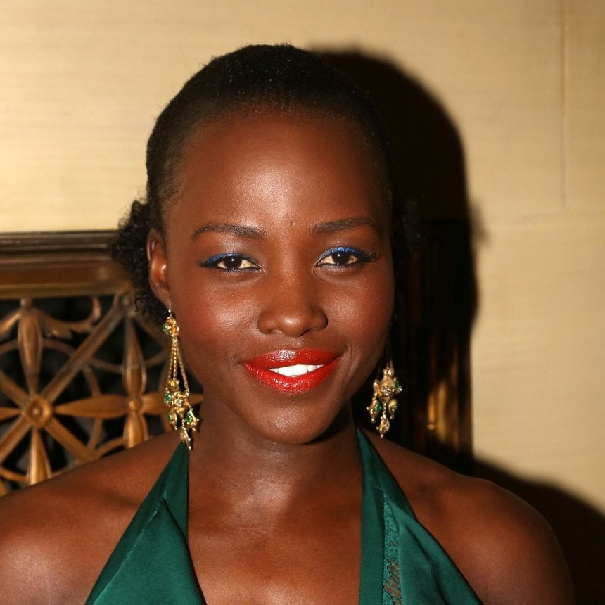 Lupita Makes A Bold Statement With Red Lip and Blue Lidss