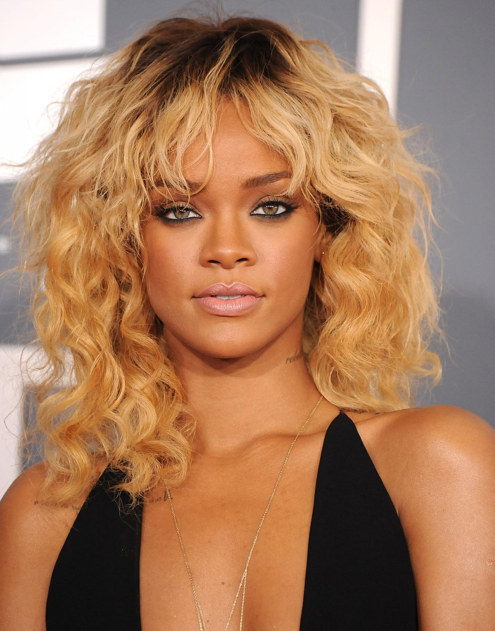 Your Guide to Rocking Curly Bangs This Spring