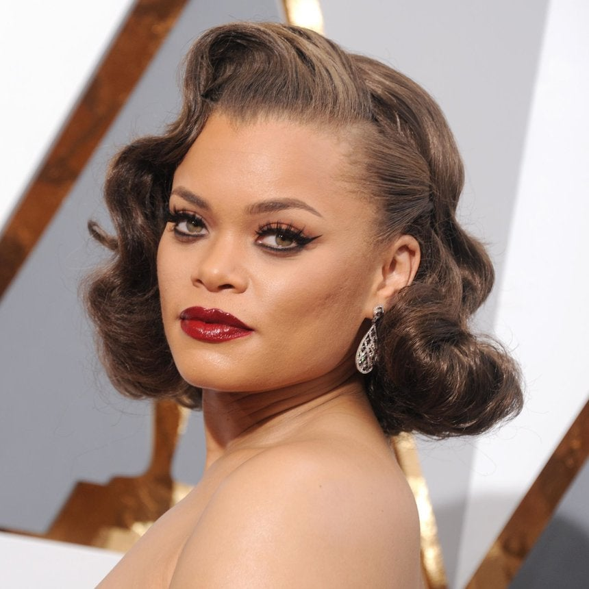 Andra Day Dishes on Her Signature Pompadour, Says 'I Avoid Hairspray'
