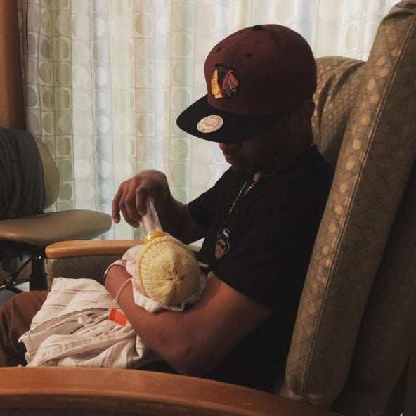 This Photo of T.I. Feeding His Newborn Daughter Will Give You All the Feels