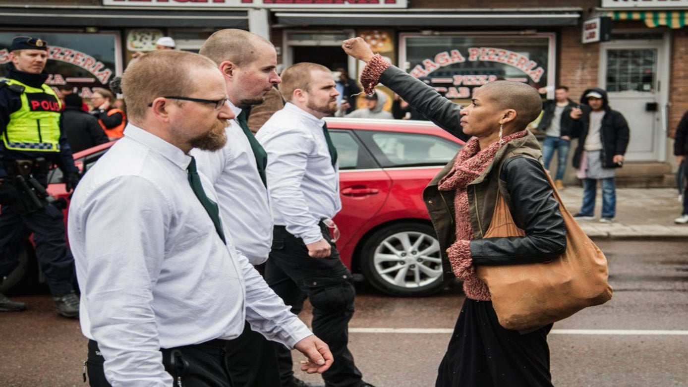 Powerful Photo of Woman Raising Black Power Fist in Front of Neo-Nazis Goes Viral