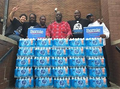 Black Men for Bernie Distribute Water to Newark Schools