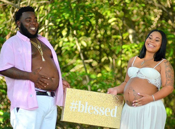Couple Rocks His and Her Baby 'Bumps' In Viral Maternity Shoot