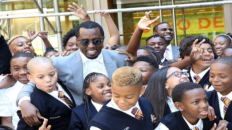Family Man Diddy Opens New Charter School in Harlem, Celebrates With Students