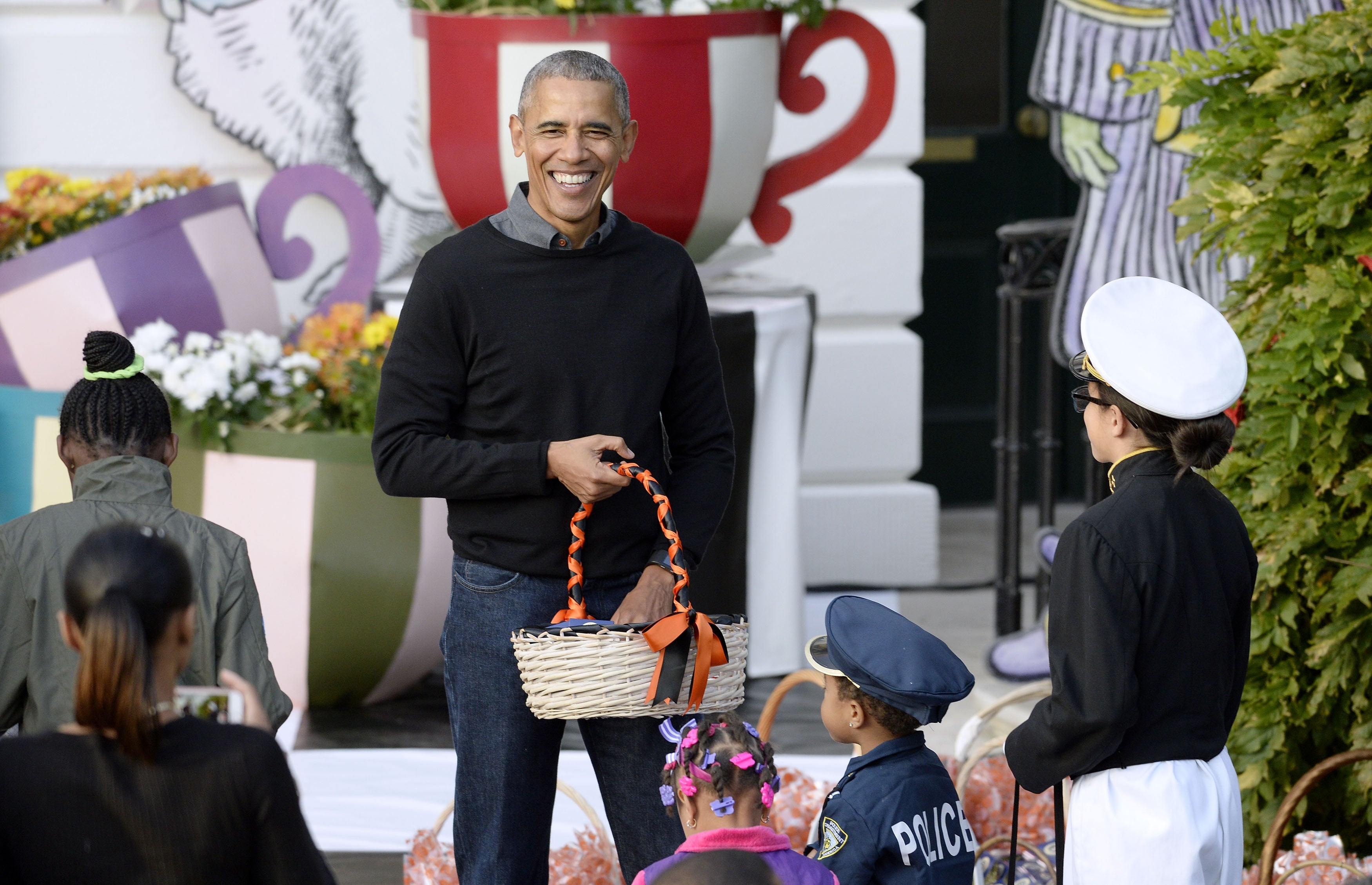 president obama sings 'purple rain' to trick-or-treater dressed as
