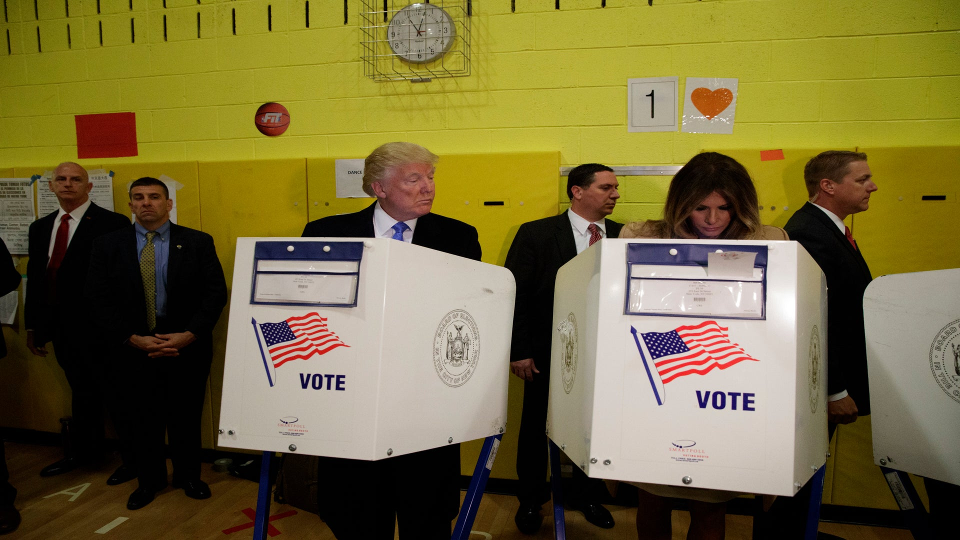 Donald & Eric Trump Couldn't Help But Check Out Their Wives' Ballots At The Polls