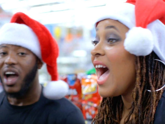 SPONSORED: Holiday Carolers Surprise a Walmart Cashier with a Little Christmas Cheer