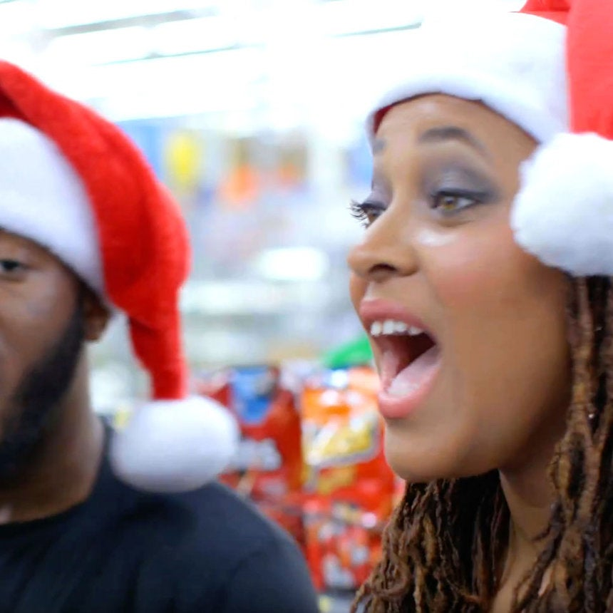 SPONSORED: Holiday Carolers Surprise a Walmart Cashier with a LittleChristmas Cheer