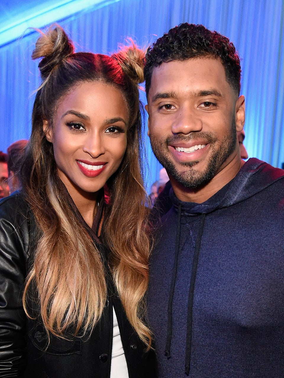 "Ciara And Her Baby Bump Cuddle Up To Russell Wilson On Private Jet – ""I Wuv This Guy"""