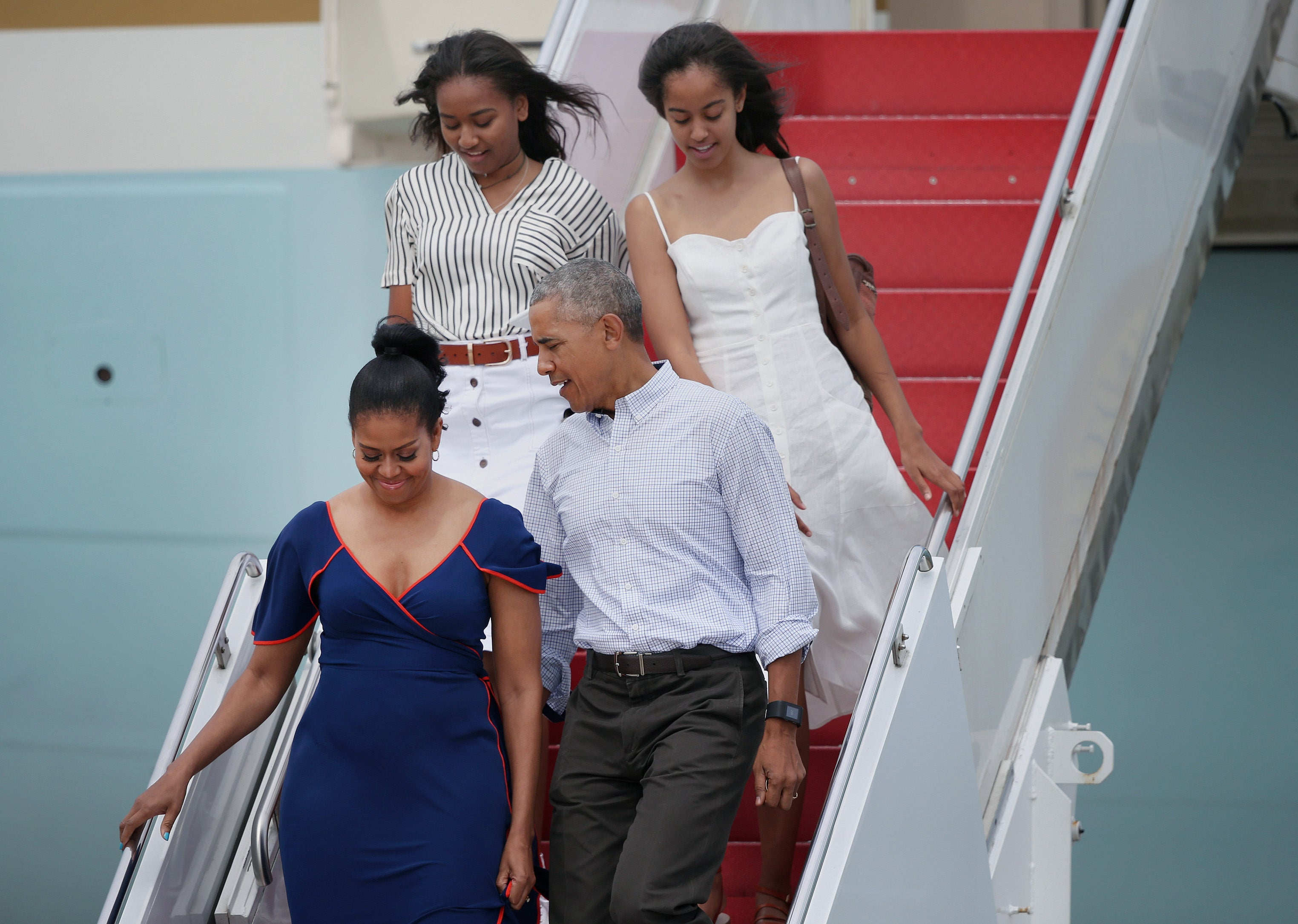 9915d90a0af Hat To The Back  Barack And Michelle Obama Spotted Living Their Best Lives  On Vacation