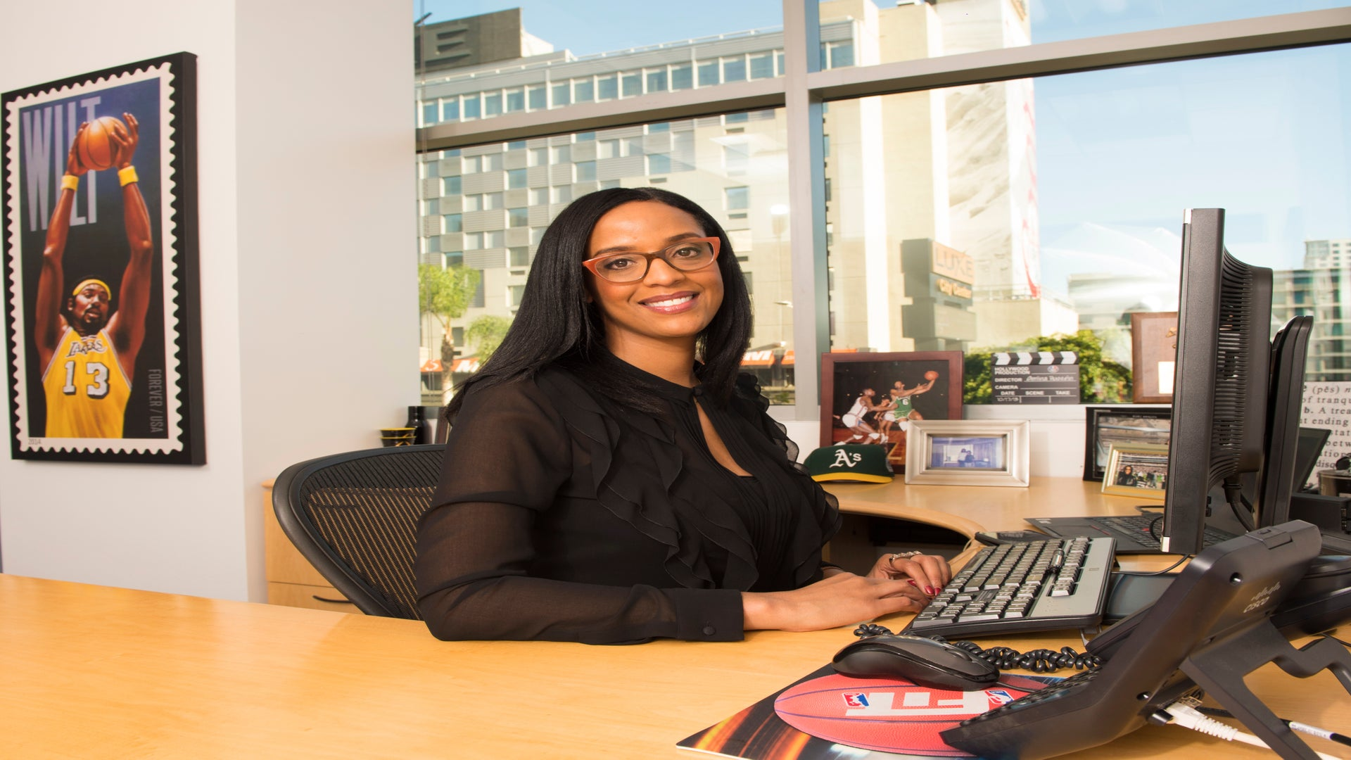 ESPN's Amina Hussein Is Shattering Glass Ceilings In Sports Media And Helping Other Women Of Color Along The Way