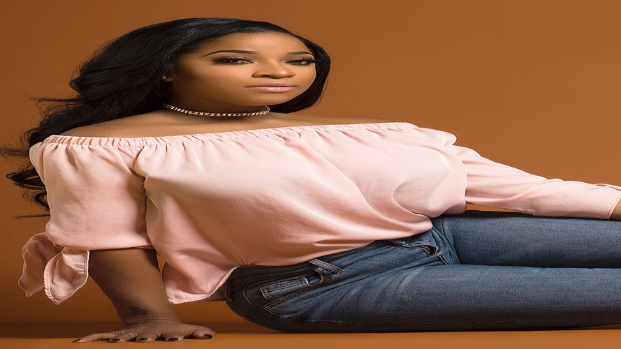 This Photo of Pregnant Toya Wright And Her Rumored Boo At Her Birthday Party Says It All