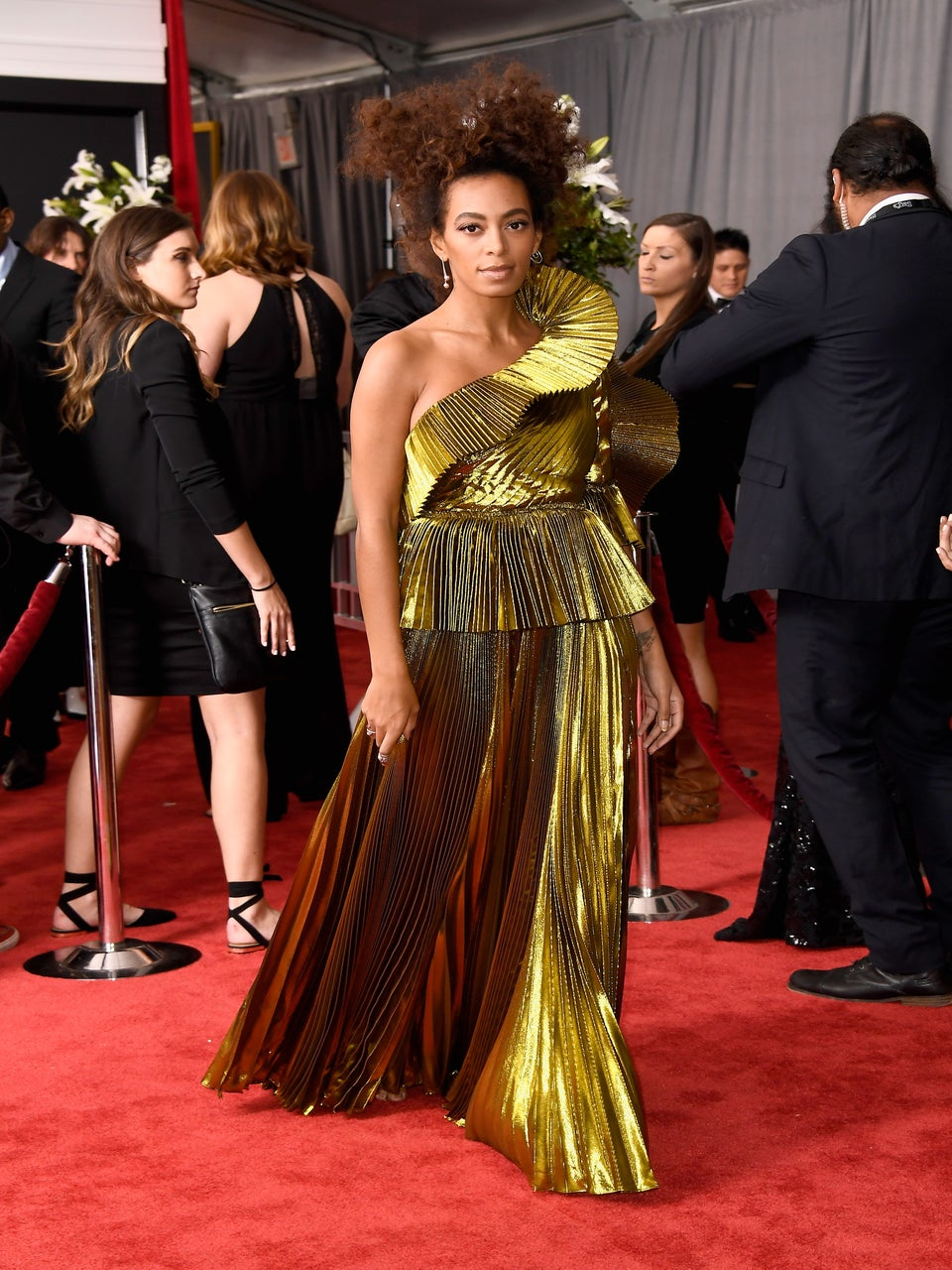 Solange Wows in Gold Gucci Gown on the Grammys Red Carpet