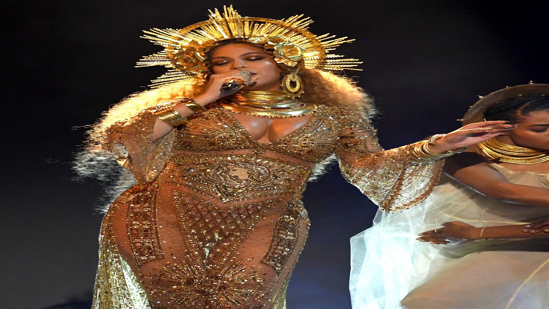 Beyoncé Lights up Grammy Awards in Breathtaking Gold Peter Dundas Gown