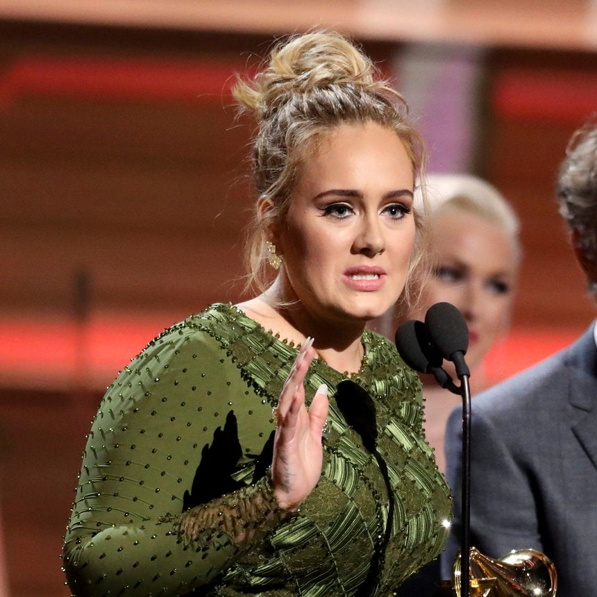 Adele Breaks Her Grammy For Album Of The Year In Half
