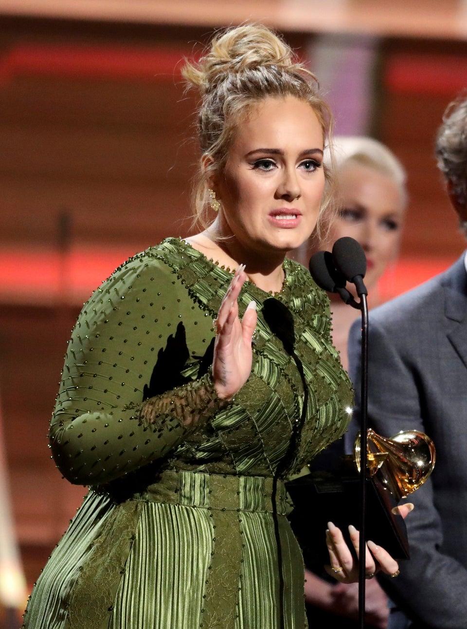 Adele Breaks Her Grammy For Album Of The Year In Half