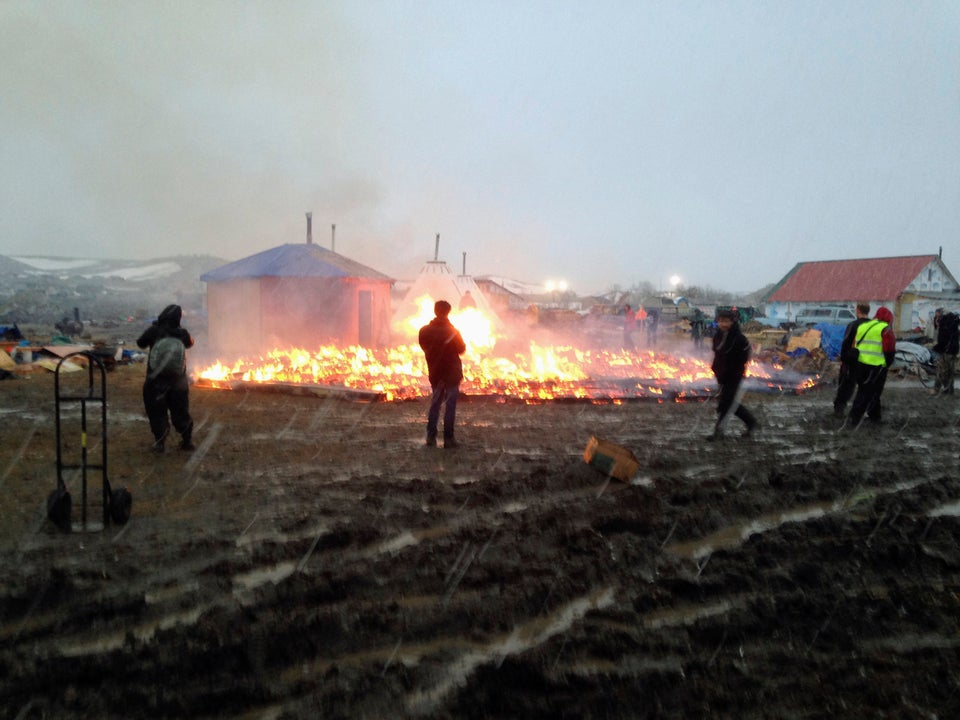 Protesters Pray And Set Fire At Dakota Access Pipeline Camp Ahead Of Shutdown