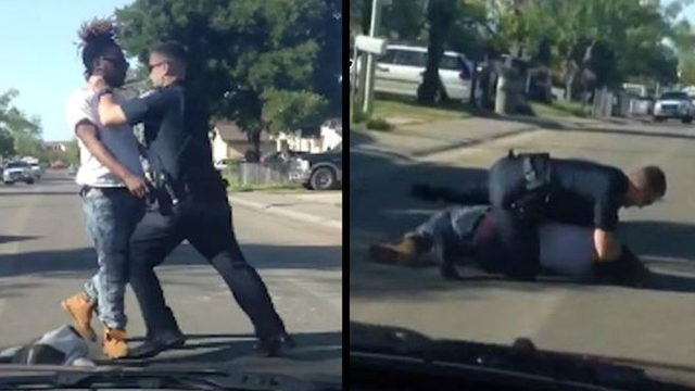 Police Officer Caught On Video Tackling and Punching Alleged Jaywalker