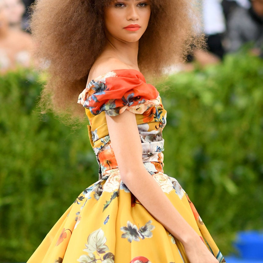 Zendaya's Coral Lip and Teased Out Afro Are The Perfect Met Gala Pairing