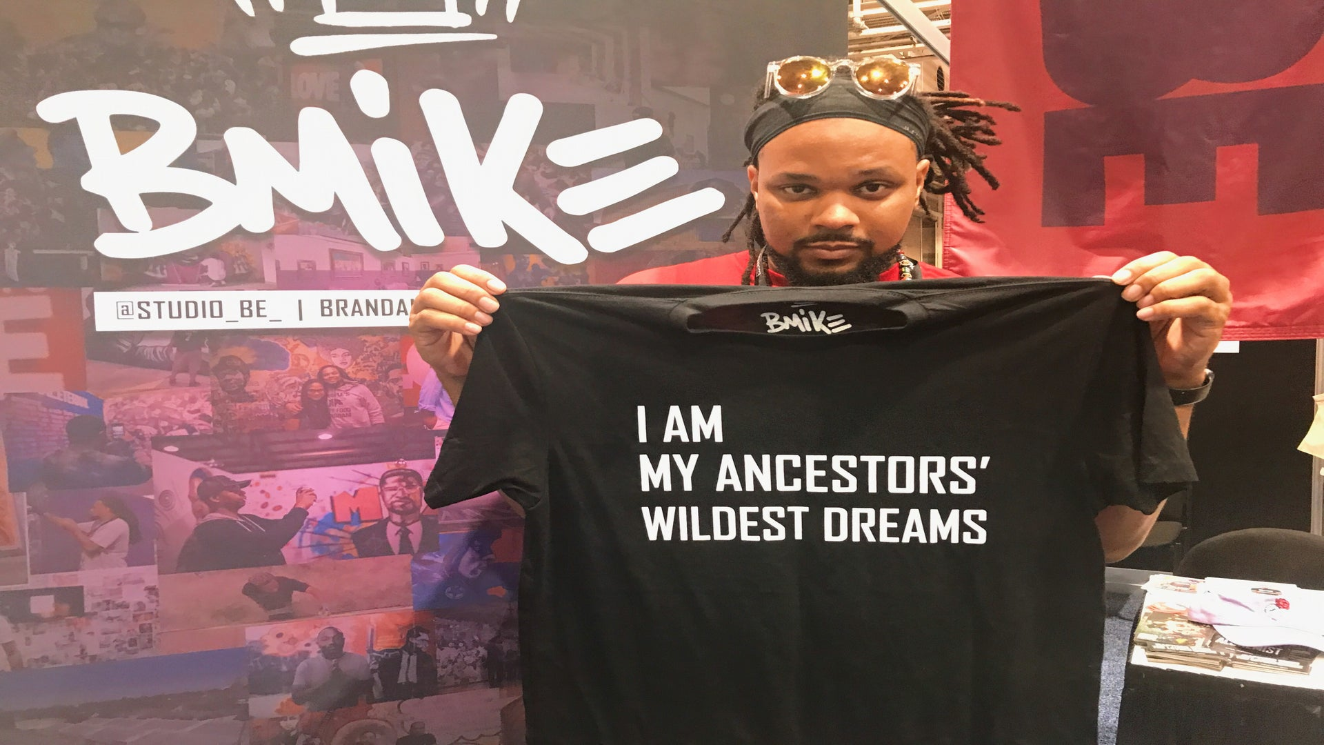 NOLA Visual Artist BMike Brings The Fight Against Injustice To Life Through His Powerful Paintings At ESSENCE Fest