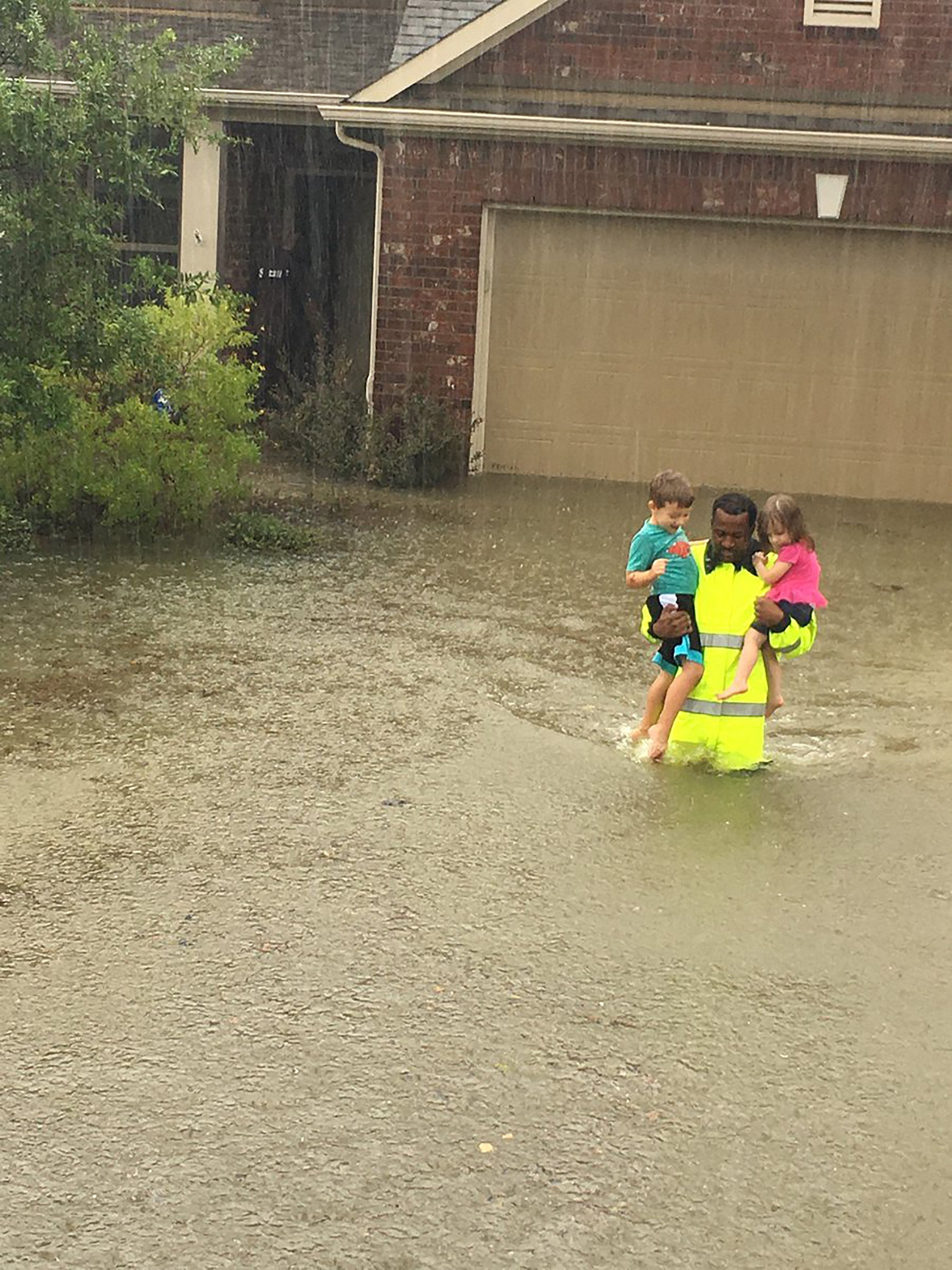 The Story Behind The Photo Of A Texas Cop Carrying 2 Kids Through Waist-Deep Water
