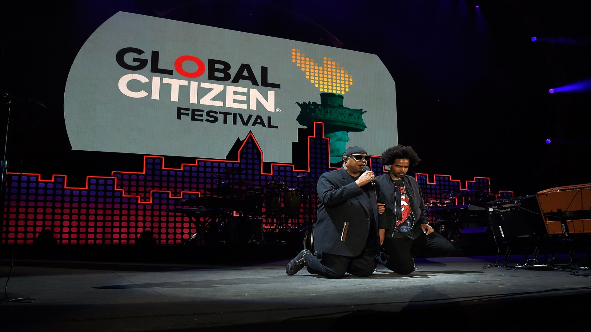 Stevie Wonder Takes A Knee 'For America' During Global Citizen Fest Performance