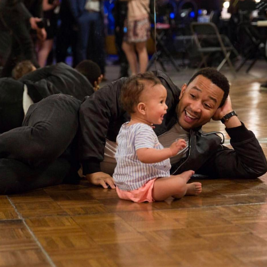 Just Like Daddy! John Legend's Daughter Luna Adorably Eats Her Dad's Favorite Meal By A Pint-Sized Piano