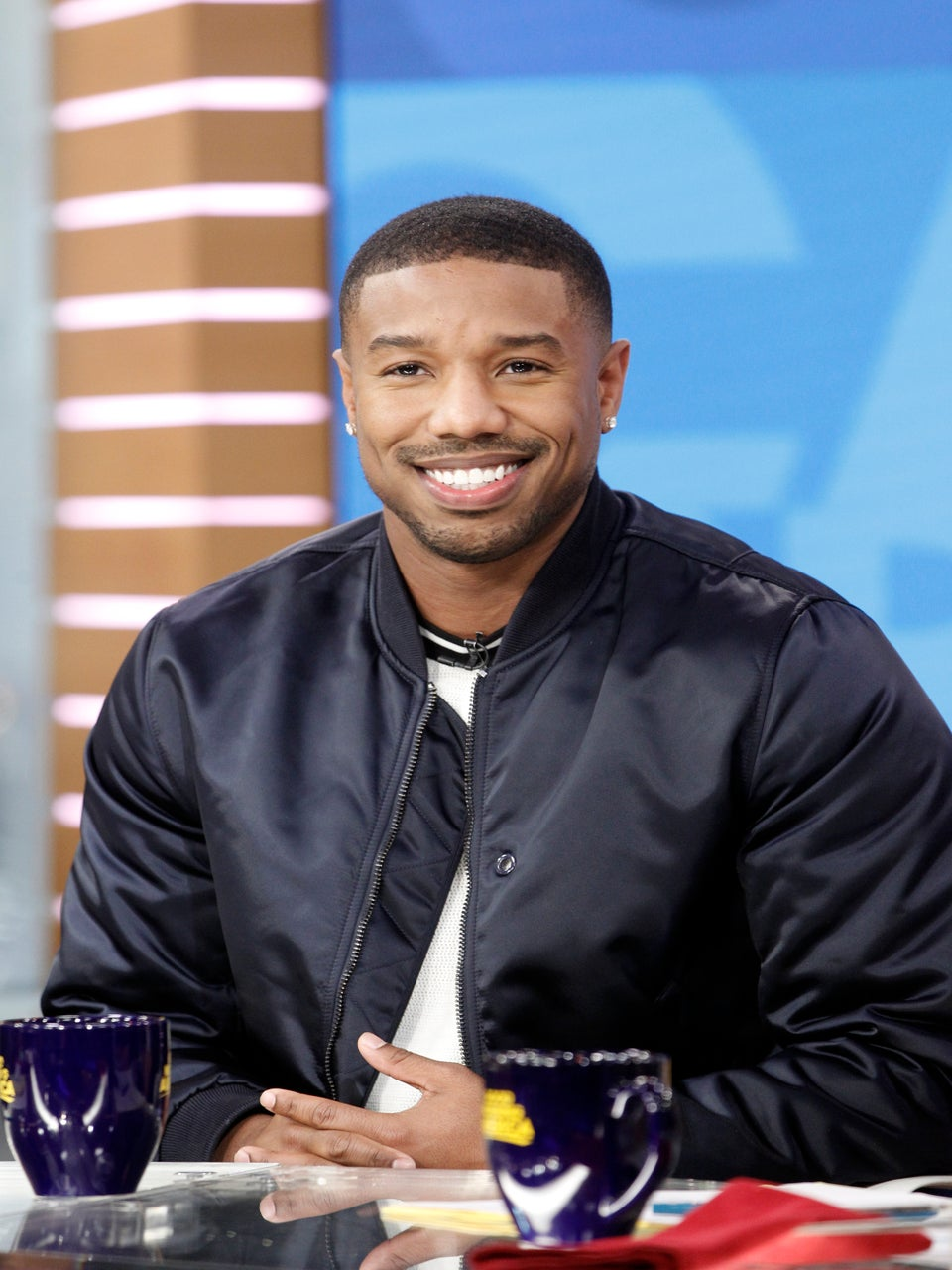 Michael B. Jordan Offered To Replace A Fan's Retainer After She Got Too Excited During 'Black Panther'