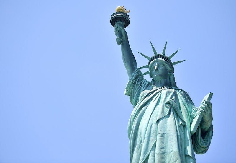 Black Woman Arrested After Climbing The Statue of Liberty In Protest