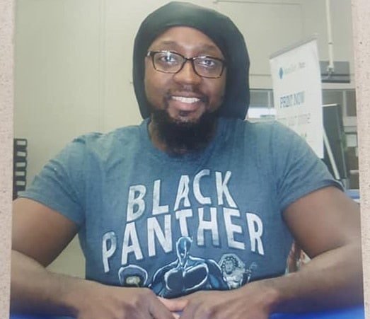 Sam's Club Employee Of The Month Asked To Retake Photo After Customer Complains About 'Blank Panther' T-Shirt