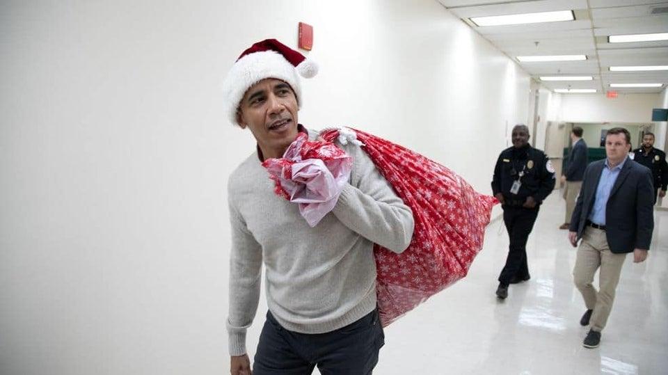 Barack Obama Visits D.C. Children's Hospital In Santa Cap