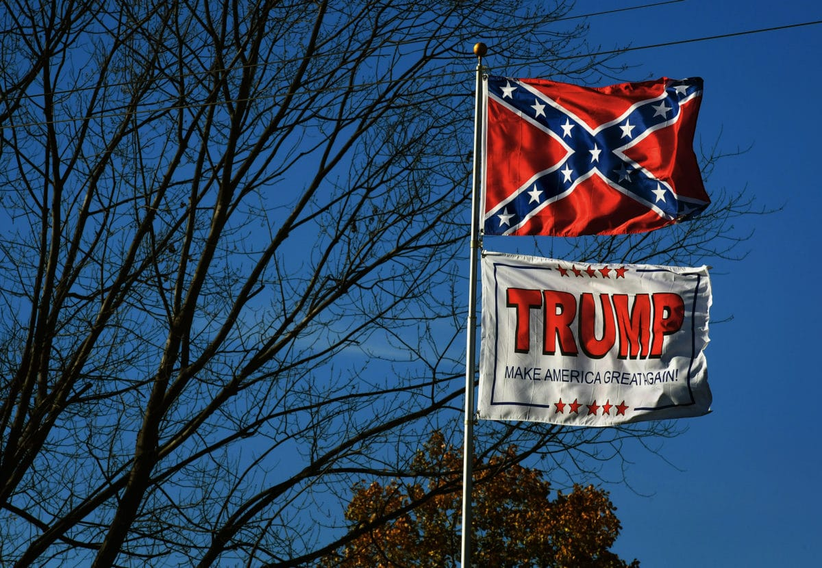 "confederate flag waves above a ""Trump"" flag in Chester, WV"